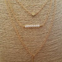 Lovely 3 layers necklace, gold plated necklace with vertical plaque, plaque of beads and small rounded charm.