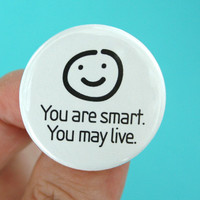 """you are smart, you may live. 1.25"""" smiley face button."""