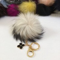 Fur pom pom keychain, bag pendant with flower charm in off white with black markings color tone
