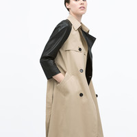 RAINCOAT WITH CONTRAST SLEEVE New