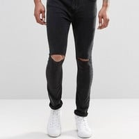 Pull&Bear | Pull&Bear Super Skinny Jeans In Washed Black With Knee Rips at ASOS