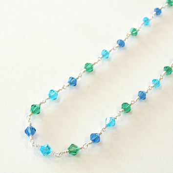 Necklace aqua mix glass beads on silver rosary wrapped wire style chain with silver toggle clasp.