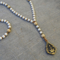 enlightment, white wood and sandalwood rosary style necklace with Buddha pendant