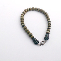 Sage green beaded bracelet with tulip accents