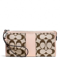 BOXED LEGACY ZIPPY WALLET IN PRINTED SIGNATURE FABRIC
