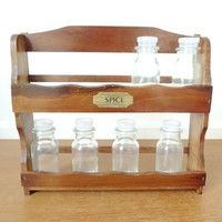 New old stock two shelf wood spice rack with 12 glass spice jars, never used, 11x9 inches