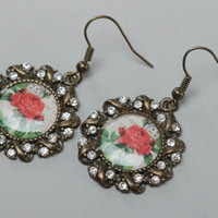 Handmade stylish earrings of glassy glaze and metal with beads in vintage style