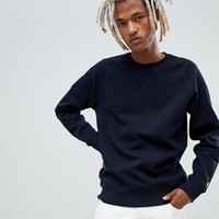 Carhartt WIP Chase regular fit sweatshirt in navy at asos.com