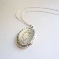Silver locket necklace with victorian embossed detail on sterling silver chain