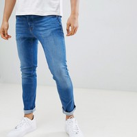 River Island skinny jeans in mid wash blue at asos.com