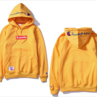 Tide brand Champion wild couple pure color embroidery cotton long - sleeved velvet hooded sweater Men Orange