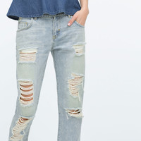BLEACHED BOYFRIEND JEANS WITH RIPS