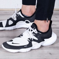 NIKE Free Rn 5.0 is a hot seller of men's netted breathable elastic outsole sneakers