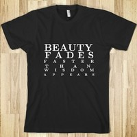 Supermarket: Beauty Fades Faster Than Wisdom Appears T-Shirt from Glamfoxx Shirts