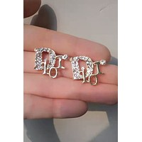 DIOR sells gold letter earrings with diamond earrings for ladies