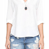 Deep V Blouse with Dipped Hem