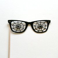 Photo booth prop spider web ray ban glasses on a stick