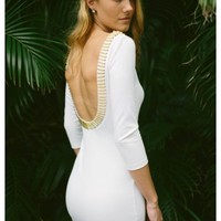Double knit white bodycon dress featuring a gold bar trim and plunging scoop back   Vera   escloset.com