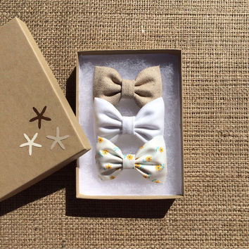 Tan, white denim, and yellow daisy hair bow set from Seaside Sparrow. These hair bows make a perfect gift for her.