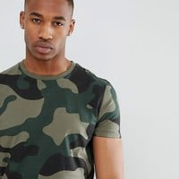 ASOS DESIGN t-shirt in all over camo print at asos.com