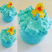 Rubber Duckie Bath Bomb. Bathtime Fun. Blue Bath Water. Rubber Duckie. Bath Time. Dead Sea Salts. Moisturizing Bath. Party Favors.