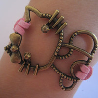 Antiqued Bronze Hello Kittie Bracelet / Pink Leather Rope