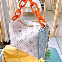 Lv Hobo series soft suitcase with orange chain bag white