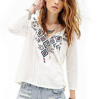 Long Sleeve Drawstring Top With Front Geometric Print
