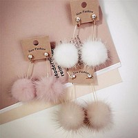 Pom Pom Long Drop Earrings