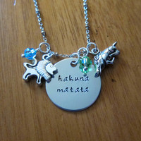 """Disney's """"Lion King"""" Inspired Necklace. Hakuna Matata. Silver colored, Swarovski crystals, for women or girls"""