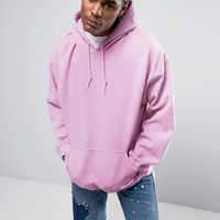 Reclaimed Vintage Inspired Oversized Hoodie In Pink Overdye at asos.com