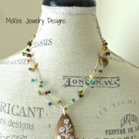 Wood pendant with hand painted flowers  and Czech Picasso glass cording necklace.
