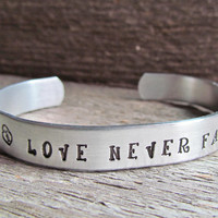 Hand Stamped Love Never Fails Cuff Bracelet Silver Aluminum Word Quote Jewelry Inspirational