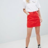 ASOS DESIGN denim mini skirt in red at asos.com