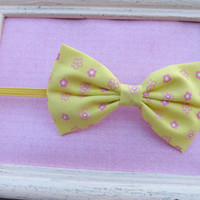 Sweet light yellow with pink flowers fabric bow headbands for babies, toddlers, teens, and adults.          ~FABRIC BOW DEPOT~