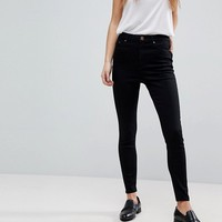 ASOS DESIGN Ridley high waist skinny jeans in clean black at asos.com