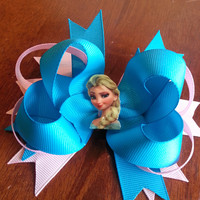 Elsa is the main features in this Frozen character blue and pink bow