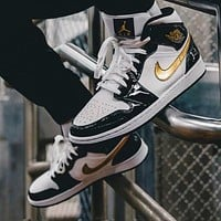 Air Jordan 1 mid-top black gold toe basketball shoes