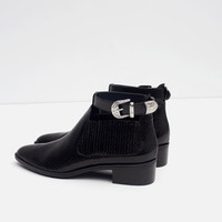 FLAT BOOTIE WITH ANKLE STRAP