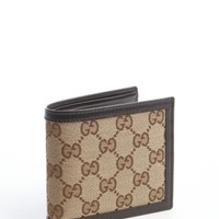 Gucci: brown GG canvas bi-fold wallet