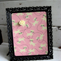 Framed Magnet Board with a vintage black filigree Frame and Pink Fabric featuring Cream colored Kittens includes a Rose Magnet