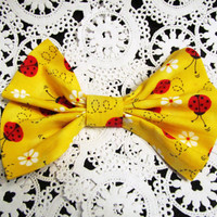 Lady bugs on a bright yellow fabric hair bow or