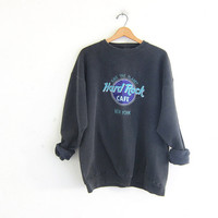 Vintage Hard Rock Cafe New York novelty sweatshirt // washed out faded black / size XL