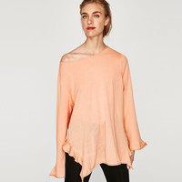 SWEATER WITH SIDE RUFFLES DETAILS