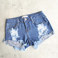 Low Rise Fitted Cut Off Distressed Shorts in Mid Wash Denim