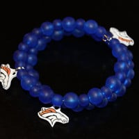 Denver Bronco memory wire bracelet with blue glass beads and Bronco charms, on clasp