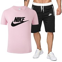 NIKE 2019 new men and women models wild casual sports suit two-piece Pink