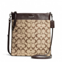 BLEECKER LARGE SWINGPACK IN SIGNATURE COATED CANVAS