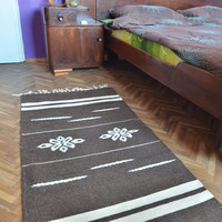 Handwoven wool rug - brown with white stripes and white flower ornaments - stylish handmade rug
