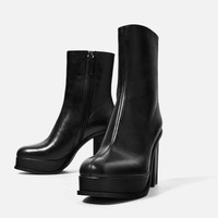 LEATHER ANKLE BOOTS WITH LINED PLATFORM DETAILS